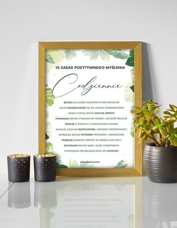Plakat motywacyjny w złotej ramce